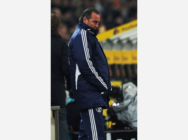 Schalke's Dutch head coach Huub Stevens reacts after the German first division Bundesliga football match Borussia Moenchengladbach vs FC Schalke 04 in the western German city of Moenchengladbach on February 11, 2012. Moenchengladbach won 3-0. AFP PHOTO / PATRIK STOLLARZRESTRICTIONS / EMBARGO - DFL LIMITS THE USE OF IMAGES ON THE INTERNET TO 15 PICTURES (NO VIDEO-LIKE SEQUENCES) DURING THE MATCH AND PROHIBITS MOBILE (MMS) USE DURING AND FOR FURTHER TWO HOURS AFTER THE MATCH. FOR MORE INFORMATION CONTACT DFL.